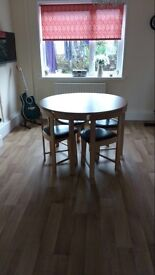 Circle dining room table and chairs