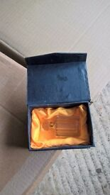 pink perfume bottle in box