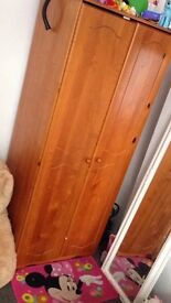 Wooden wardrobe bedside table and chest of draws.