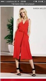 Karen Millen red jumpsuit. Beautifully tailored. Size 12. Worn once for wedding in summer