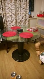 Glass top table with marble bottom very heavy