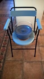 New in box portable commode