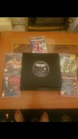 PS3 with 2 remotes and games!!!