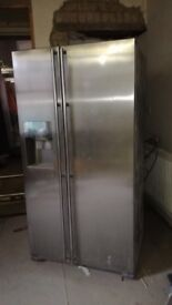 One year old American-style fridge freezer with ice maker
