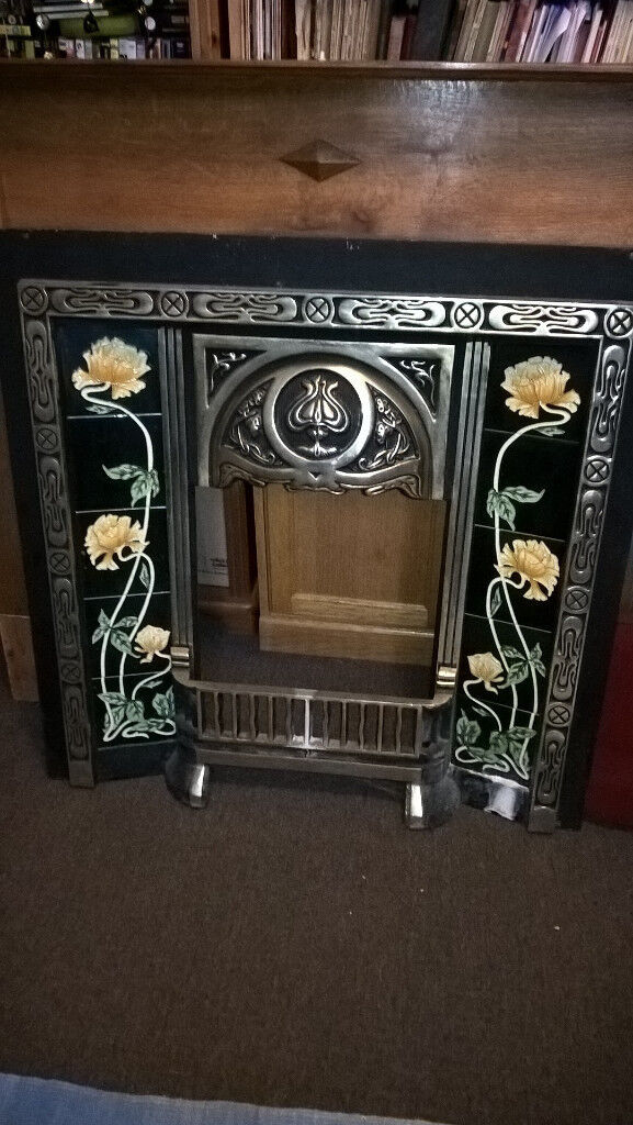 Lovely fire place surround with all tiles intact