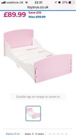 Pink and white toddler bed
