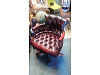 ox blood colour leather captains chair