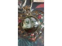 Three different hearts silver pendent with animals