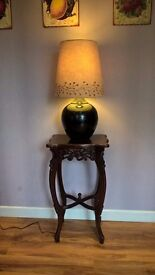 Reproduction antique side table and lamp.