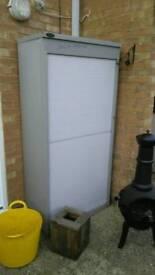Filing cabinet slide up door