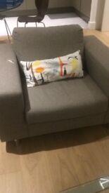 Grey armchair.