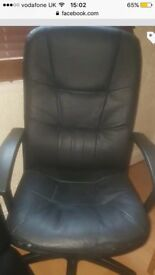 Black faux leather swivel chair