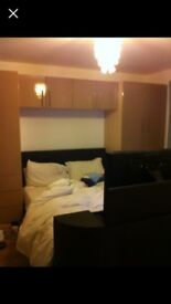 Overbed unit with wardrobes and drawers