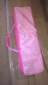 pink travel cot in good condition