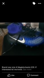 Brand new size 4 football boots ideal birthday or Christmas present
