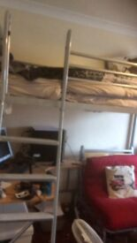 Metal high sleeper bed, desk and single pull out bed underneath