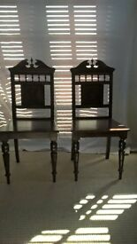 A Pair of Wooden Hall Chairs