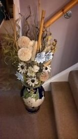 large blue pattened decorative vase complete with dried flower display