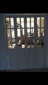 White wooden and glass double internal doors.