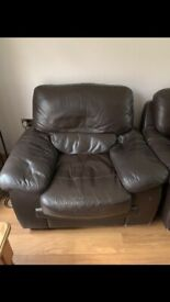 Free brown leather armchair