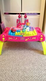 Mega blocks fold away table with blocks me figures and a car