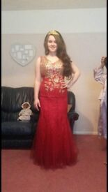 Stunning red formal dress you won't see another around