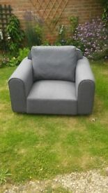Nearly new X showroom arm chair on castors Blue/Gray