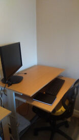 Computer desk and Chair for Sale. Adjustable Desk Height and has tires for easy movement.