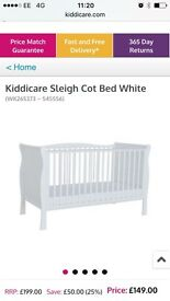 Kiddicare white sleigh cot bed. Brand new in box. Only selling as it was an unwanted gift.