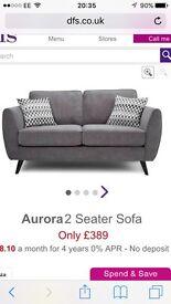 Grey fabric two seater sofa