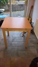 Solid extendable swivel dining table £25