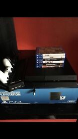 PS4 With 6 Games, 2 pads, charging station/stand
