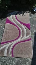 Beige, plum and cream rug