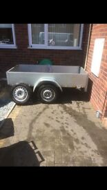 "Trailer 6'6"" X 3'6"" with spare wheel."