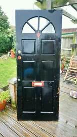 Painted hardwood front door.