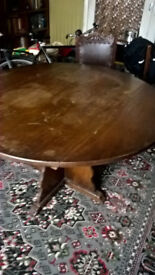 round oak dining table - with fold down leaves
