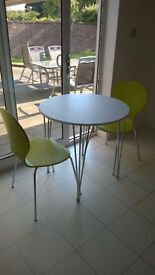 Breakfast table with two chairs in as new condition