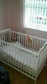 white cot with mattress and bedding included. never really been used in excellent condition.