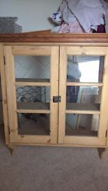 Pine wall display cabinet with glass doors - lovely piece but sadly nowhere to put it!