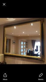 Black and gold ornate mirror