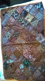 Beautiful beaded throw, ideal for the bedroom or as a wall hanging