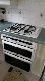Integrated gas hob and electric oven