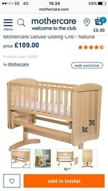 Mothercare crib - deluxe model, swinging