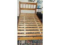 single bed frame and quilt.