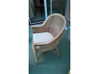 Wicker chair with cushion, ideal for conservatory