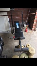 York weight bench with bar and mixed weights