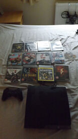 Immaculate condition PS3 500GB edition with 13 games and one controller