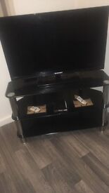 3 black glass TV stands