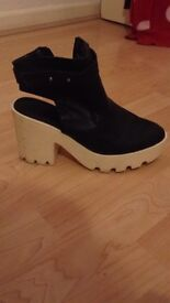 Size 5 chunky white and black boot heels