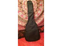 Black Acoustic Guitar by Stagg with carry case backpack!